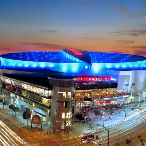 Staples Center sunset picture with a glowing blue circular roof