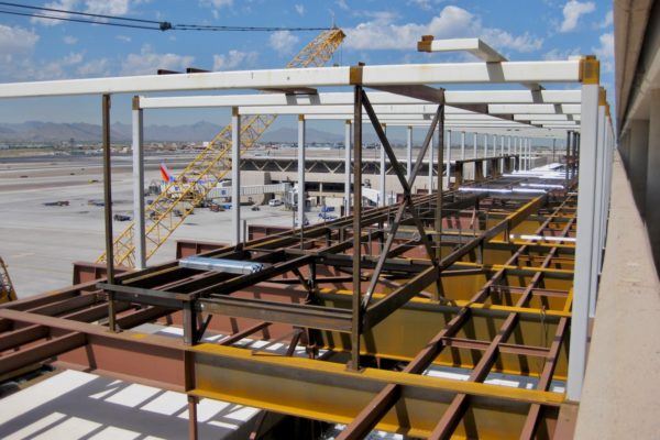 Side view of brown metal steeling during construction of Sky Harbor