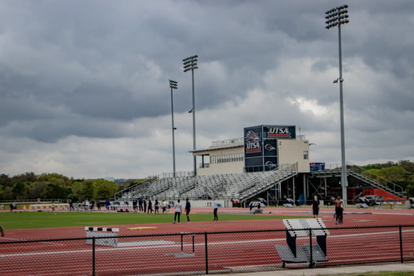 UTSA Athletic Complex view of track and bleachers with athletes