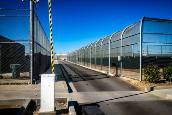 Adelanto ICE Processing Center street with gated entrance