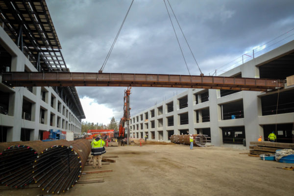 Apple Parking garage under construction and moving a metal beam