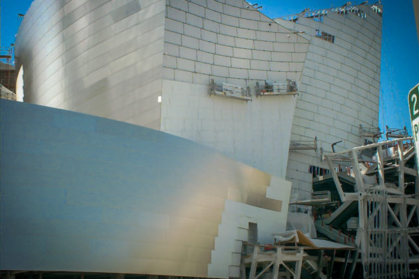 Walt Disney Concert Hall with workers putting on metal siding