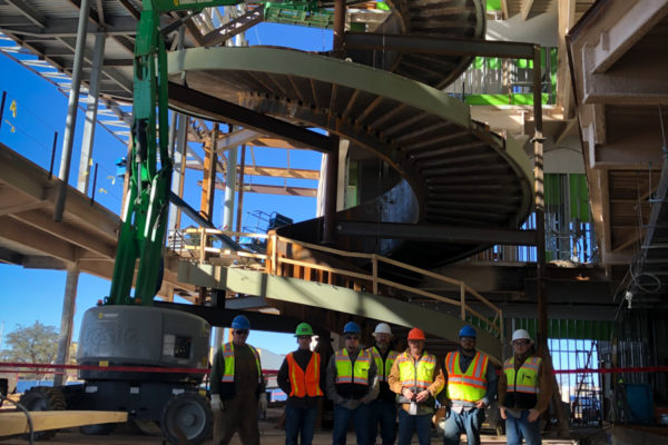 Beck Steel team standing before the Buddy Holly staircase