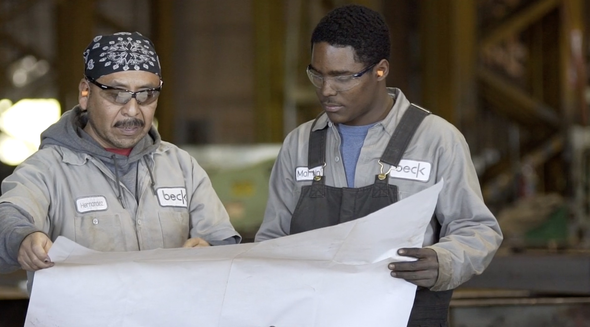 Beck steel employees viewing plans