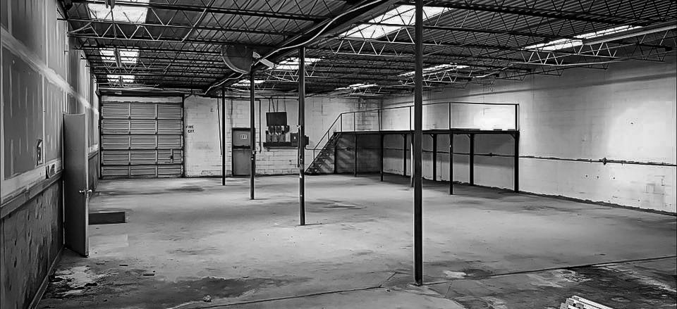 Black and white image of the first warehouse Beck Steel First used