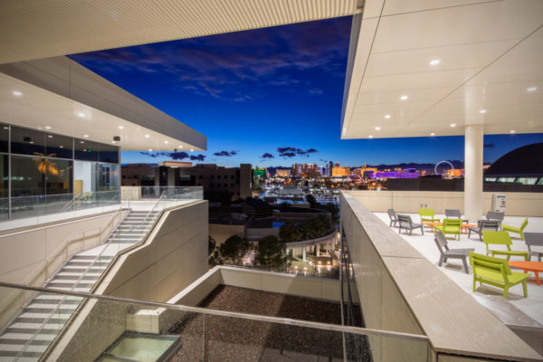 UNLV Hospitality Building interior view looking out at sunset