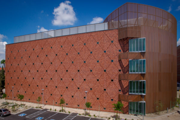 University of Arizona Chemistry red building with a diamond pattern on the side