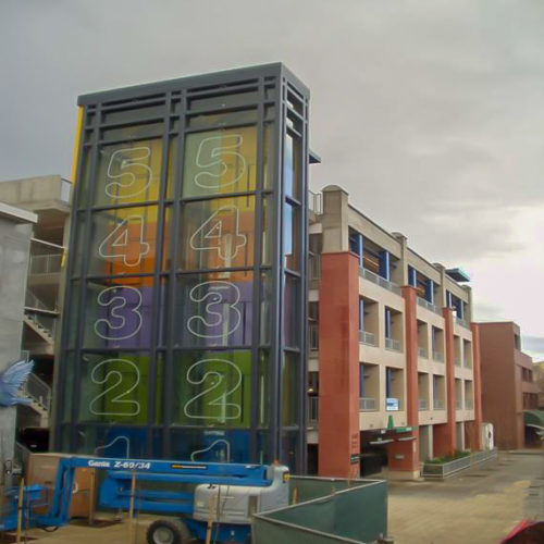 Palo Alton Parking Structure displaying the numbers on glass elevators on exterior
